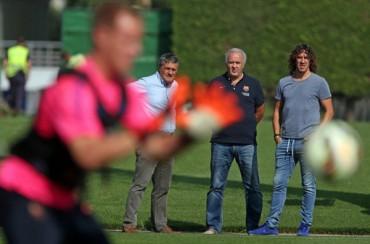 Visita de Puyol en el entrenamiento del Barcelona