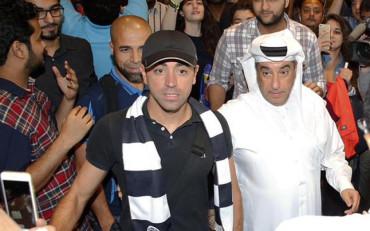 Xavi, recibido como un héroe en Qatar